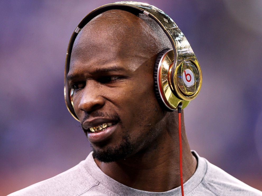 PHOTO: Chad Ochocinco Johnson of the New England Patriots waits on the field before Super Bowl XLVI at Lucas Oil Stadium on Feb. 5, 2012 in Indianapolis, Ind.