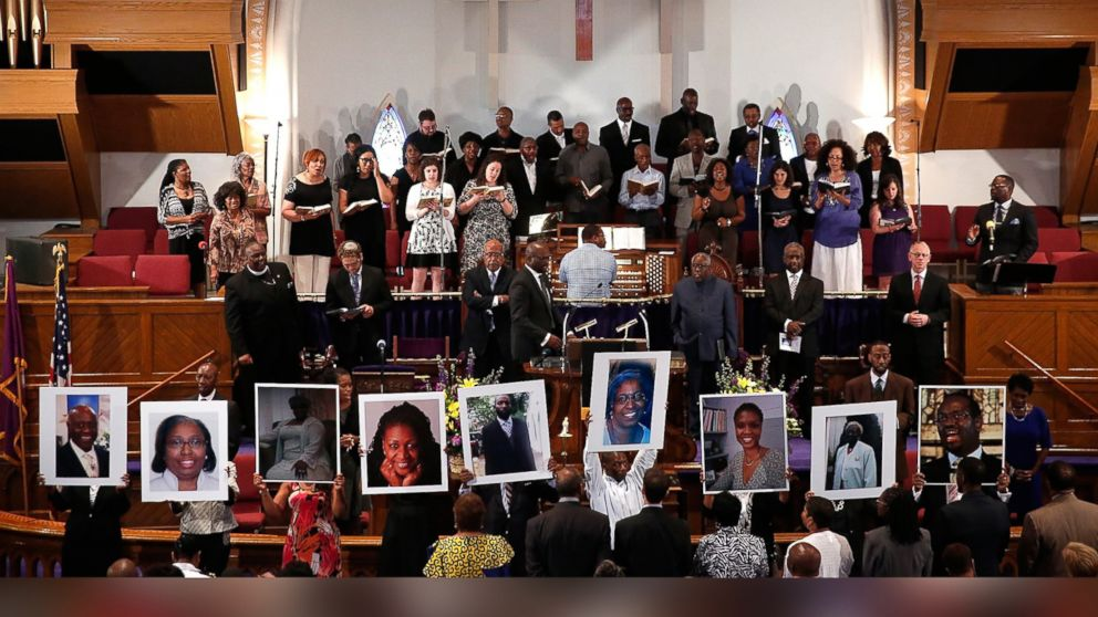 Photographs of the nine victims killed at the Emanuel African Methodist Episcopal Churuch in Charleston, S.C. are held up by congregants during a prayer vigil at the the Metropolitan AME Church June 19, 2015 in Washington, DC.