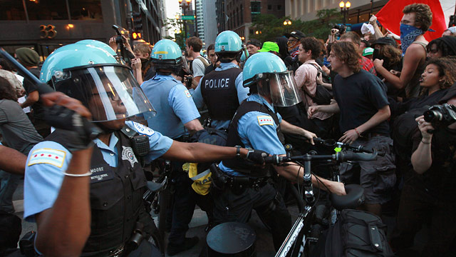 PHOTO: Demonstrators break through police lines as they march through the downtown streets on May 19, 2012 in Chicago, Illinois.