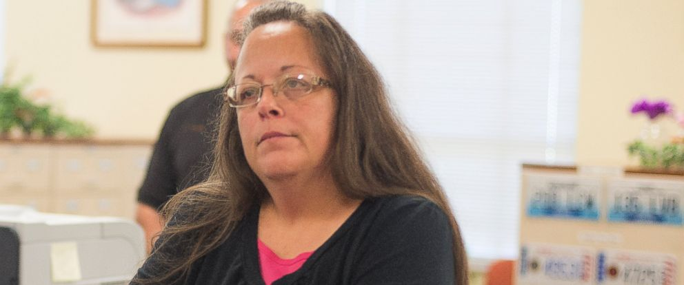 PHOTO: Kim Davis, the Rowan County Clerk of Courts, listens to Robbie Blankenship and Jesse Cruz as they speak with her at the County Clerks Office on Sept. 2, 2015 in Morehead, Ky.