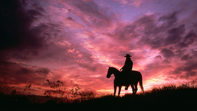 PHOTO: Cowboy riding off into the sunset