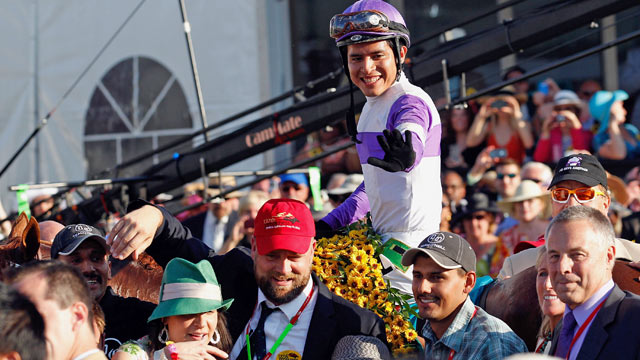PHOTO: Jockey Mario Gutierrez celebrates in the winners circle after riding Ill Have Another to win the 137th Preakness Stakes at Pimlico Race Course.