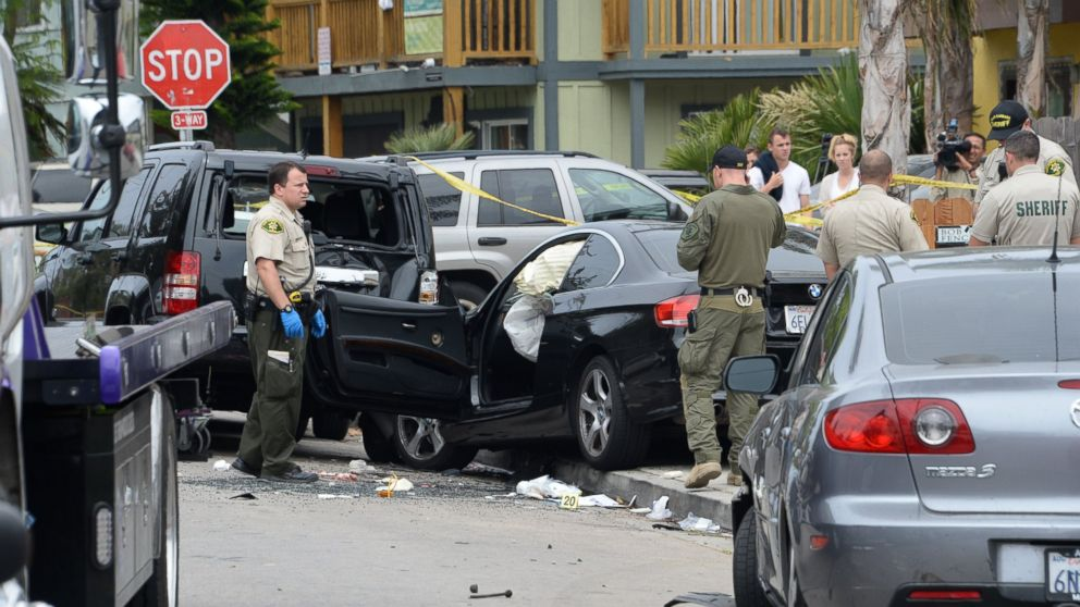 Investigators examine the car driven by Elliot Rodgers on May 24, 2014, the day after his killing spree in Isla Vista, Calif.