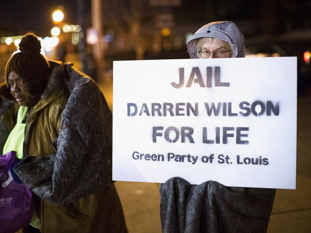 PHOTO: Demonstrators protest the shooting death of 18-year-old Michael Brown across from the police station on Nov. 17, 2014 in Ferguson, Mo.