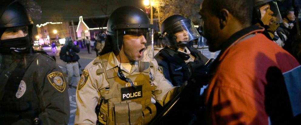 PHOTO: Police officers confront protesters after the announcement of the grand jury decision not to indict police officer Darren Wilson in the fatal shooting of Michael Brown on Nov. 24, 2014, in Ferguson, Mo.