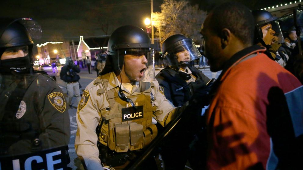 Police officers confront protesters after the announcement of the grand jury decision not to indict police officer Darren Wilson in the fatal shooting of Michael Brown on Nov. 24, 2014, in Ferguson, Mo.