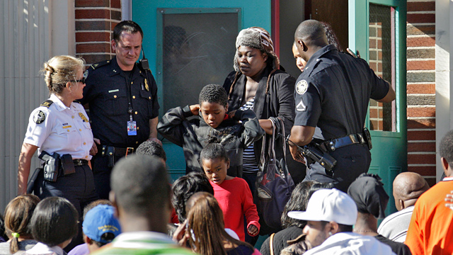 PHOTO: Anxious parents crowd the entrance to Brown Middle School where students were brought after being evacuated from Finch Elementary School in Atlanta, Dec. 3, 2012.