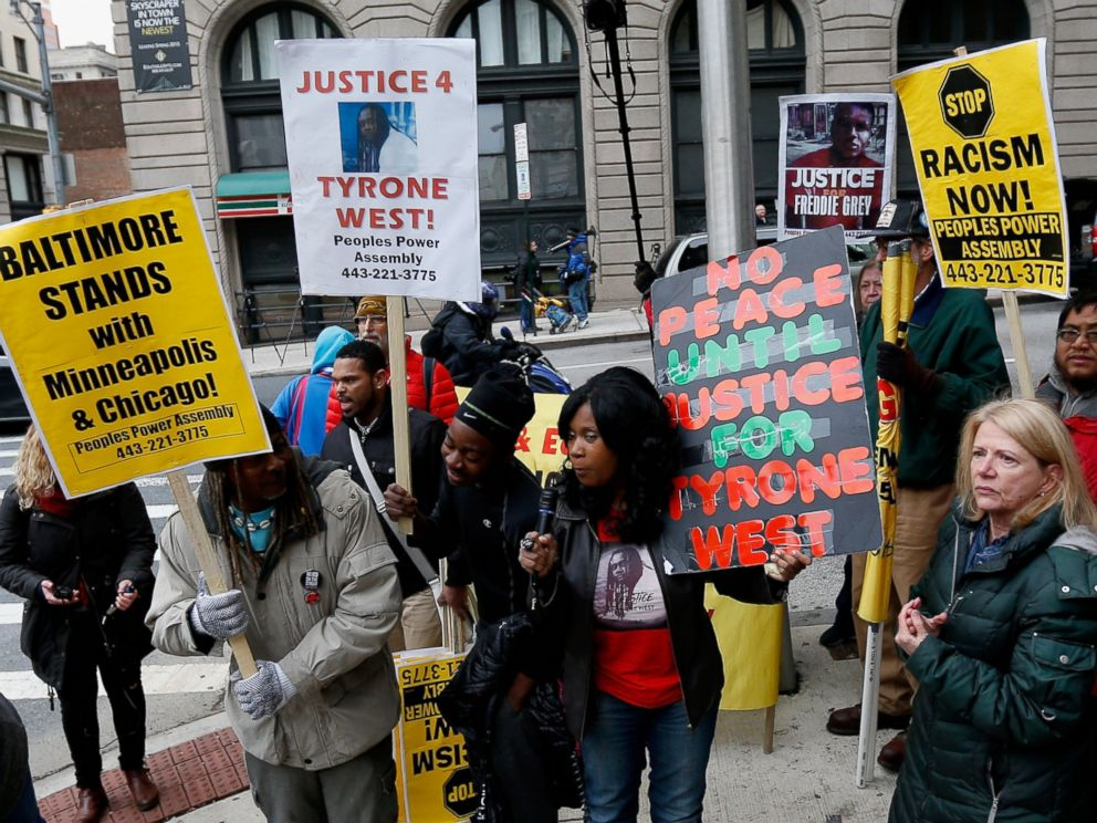 PHOTO:Protestors hold up signs in front of the courthouse where jury selection began in the trial of William Porter, one of six Baltimore city police officers charged in connection to the death of Freddie Gray, Nov. 30, 2015, in Baltimore.