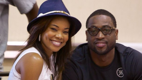 PHOTO: Gabrielle Union and Dwyane Wade pose for photos at the Westin Diplomat on Aug. 3, 2014 in Hollywood, Fla.