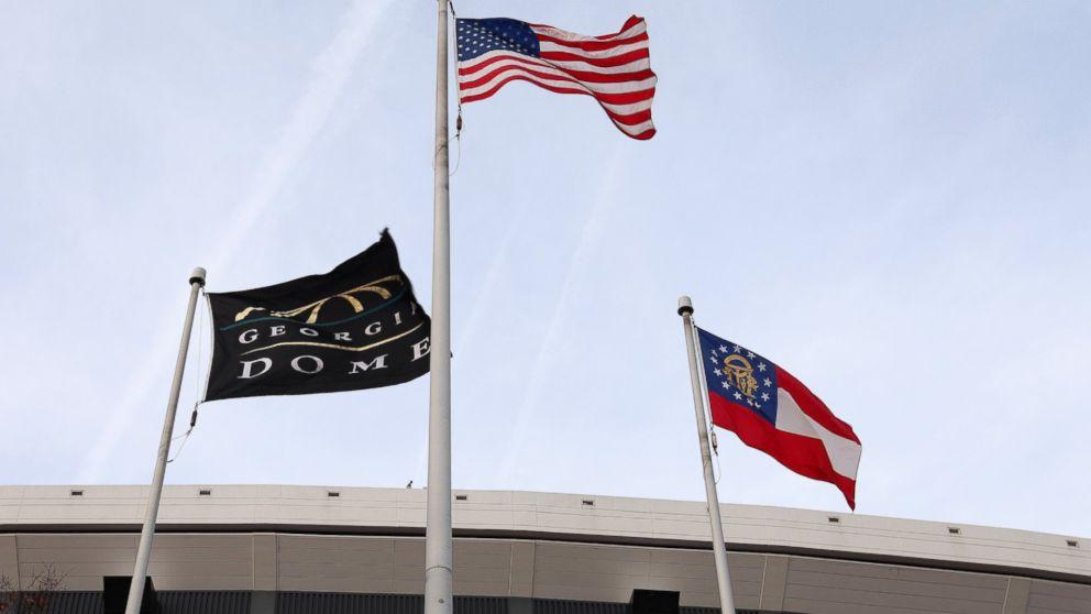 Georgia Dome Flag, American Flag and the Georgia State Flag, flies outside the Georgia Dome in Atlanta, Georgia on Nov. 23, 2013.