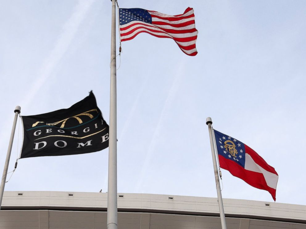 PHOTO: Georgia Dome Flag, American Flag and the Georgia State Flag, flies outside the Georgia Dome in Atlanta, Georgia on Nov. 23, 2013.