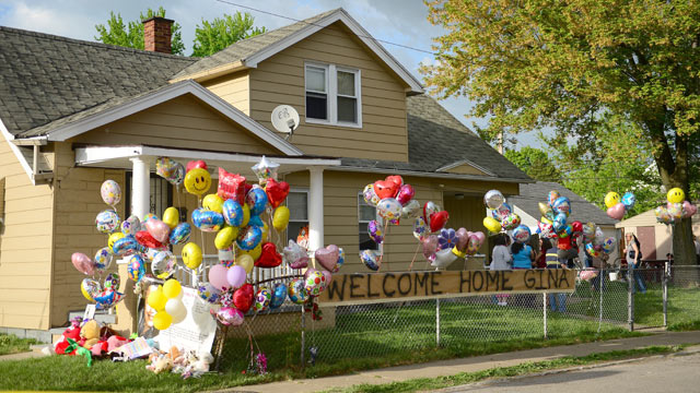 PHOTO: The family house of Gina DeJesus, one of the three women which were held captive for a decade, is decorated by well wishers May 7, 2013 in Cleveland, Ohio.