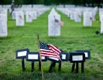 PHOTO: A flag is seen at the temporary marker for a mass grave in Section 60 at Arlington National Cemetery May 24, 2012 in Washington, DC.