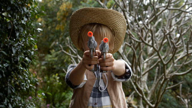 PHOTO: Boy a plays with toy gun.