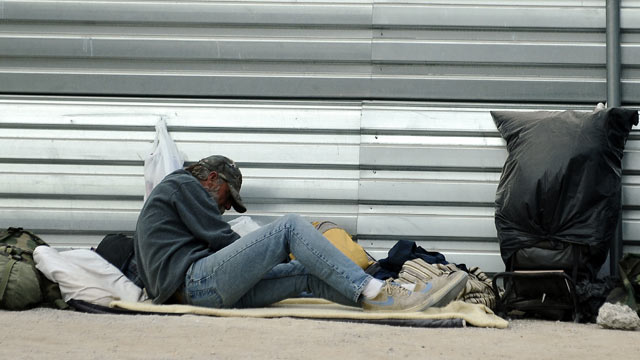 PHOTO: A homeless man rests beside a street in Las Vegas, November 13, 2011. Permanent supportive housing has made big strides in reducing homelessness this decade.
