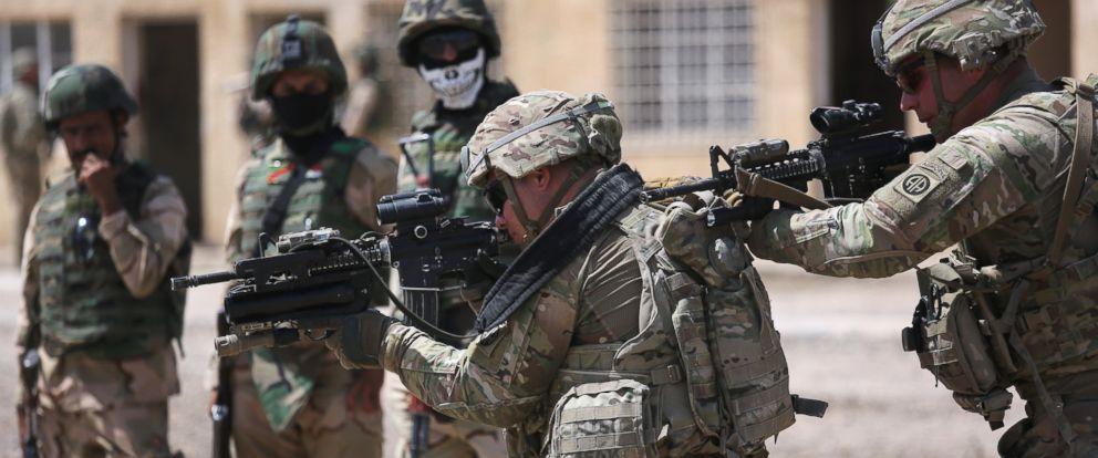 PHOTO: U.S. Army trainers instruct Iraqi Army recruits at a military base on April 12, 2015 in Taji, Iraq.