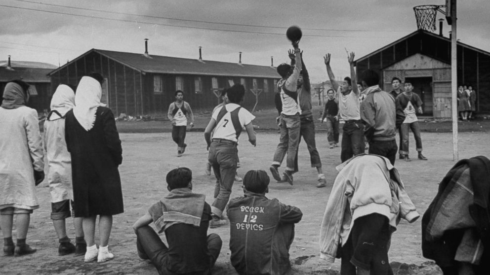 Young men play basketball at a Japanese internment camp in Tule Lake, Calif. in 1944.