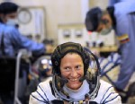 PHOTO: Member of the International space crew US astronaut Karen Nyberg smiles during space suits test, prior to blast off to the International Space Station (ISS) from the Russian-leased Kazakh Baikonur cosmodrome, on May 28, 2013.