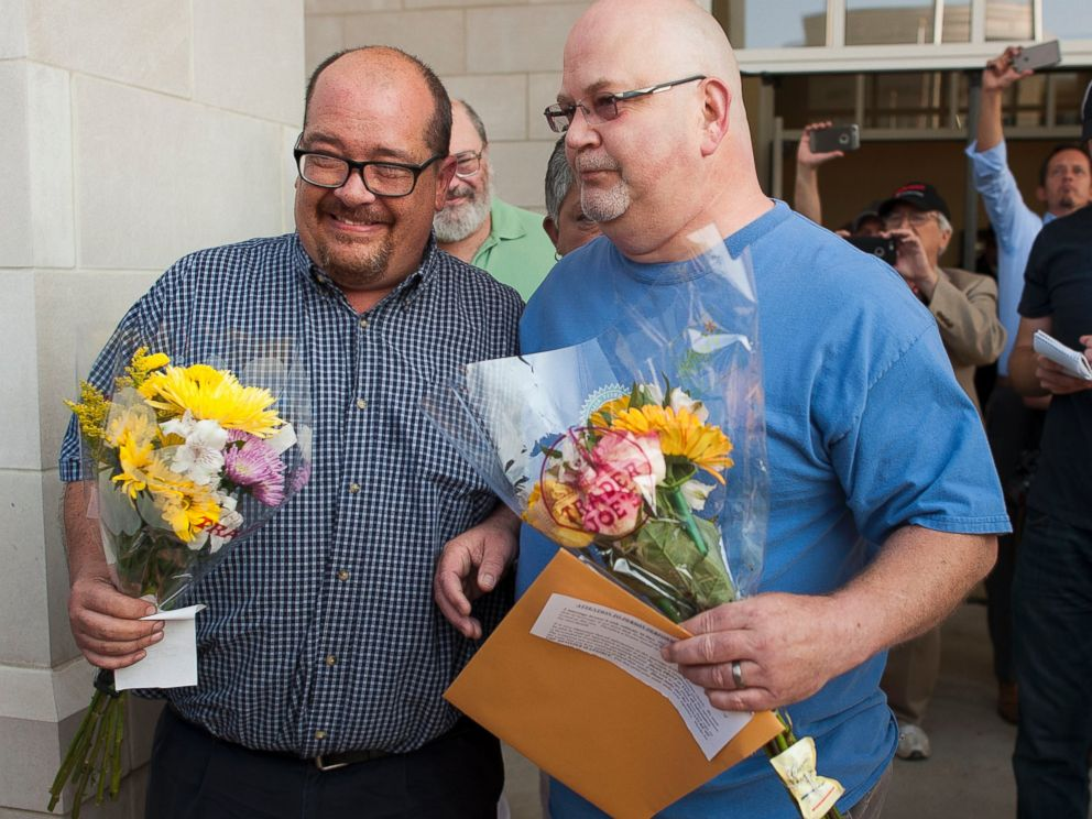 PHOTO: Michael Long and Timothy Long stand in front of the Rowan County Courthouse after receiving their legal marriage license, Sept. 3, 2015 in Morehead, Ky.