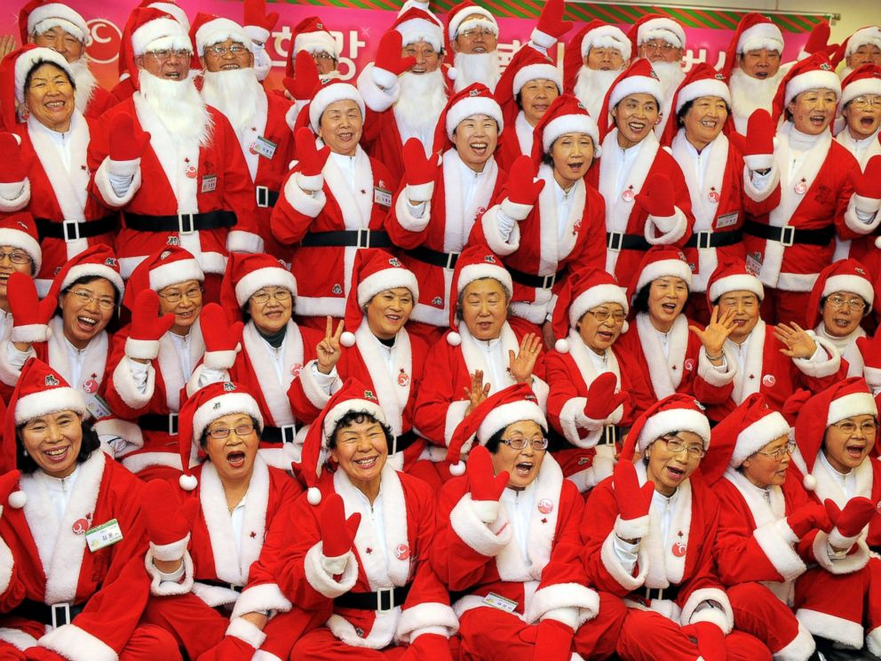 PHOTO: South Korean senior volunteers, clad in Santa Clause costumes, pose for a picture during a chairty event on December 15, 2009.