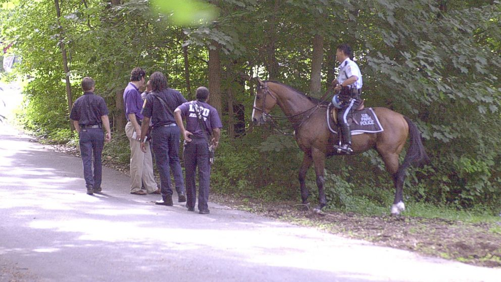 US Park police and fire fighters searching wooded area of park for evidence leading to whereabouts of missing Washington intern Chandra Levy, July 16, 2001.