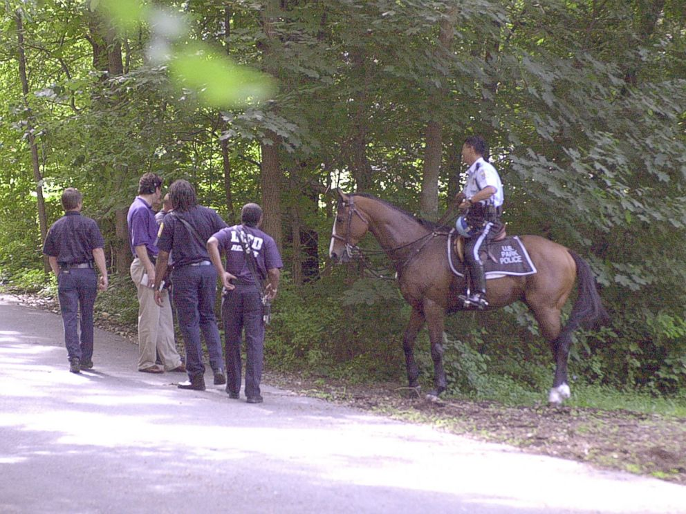 PHOTO: US Park police and fire fighters searching wooded area of park for evidence leading to whereabouts of missing Washington intern Chandra Levy, July 16, 2001.