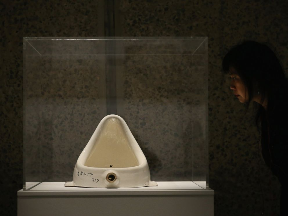PHOTO: A woman looks at Fountain by Marcel Duchamp during a press preview of an exhibition at the Barbican Art Gallery on Feb. 13, 2013 in London.