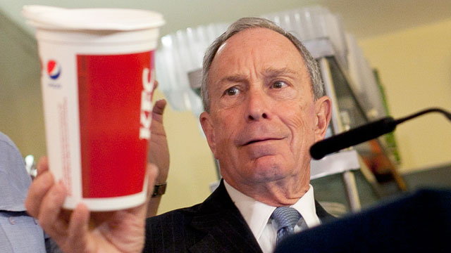 PHOTO: New York City Mayor Michael Bloomberg holds a large cup as he speaks to the media about the health impacts of sugar at Lucky's restaurant, which voluntarily adopted the large sugary drink ban, March 12, 2013 in New York City.