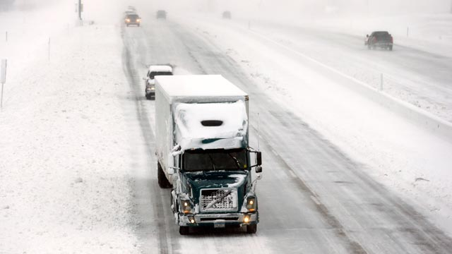 PHOTO: A truck makes its way down a snow covered Interstate I-35/I-80, Dec. 20, 2012, in Des Moines, Iowa.
