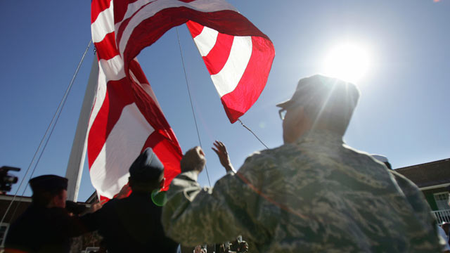 "PHOTO: A replica of the famous flag Francis Scott Key witnessed ""by the dawn's early light"" is raised by newly naturalized citizens during a US Naturalization Ceremony for 17 active duty military candidates Sept. 24, 2007 at the Fort McHenry National Monu"