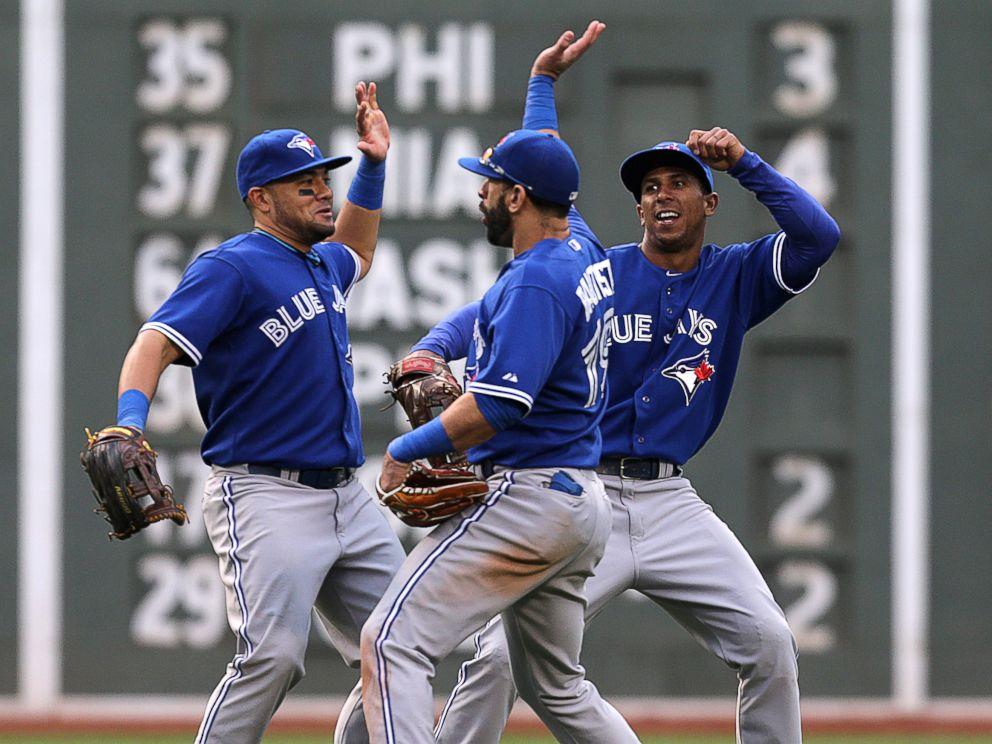 PHOTO:Melky Cabrera, Toronto, Jose Bautista, and Anthony Gose of the Toronto Blue Jays celebrate the 7-2 win with a dance in the outfield.