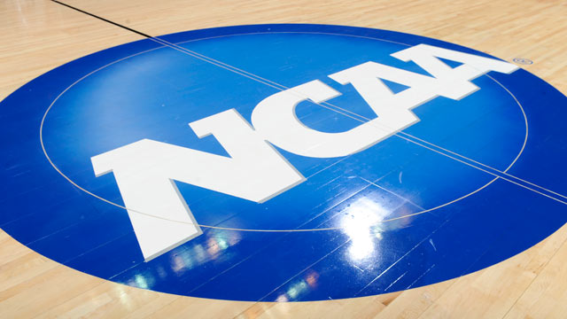 PHOTO: The NCAA logo on the basketball court is seen during the third round of the 2011 NCAA men's basketball tournament March 19, 2011 in Washington, DC.