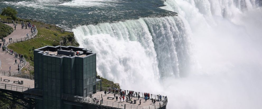 PHOTO: Tourists stand atop the Prospect Point Observation Tower overlooking Niagara Falls on June 4, 2013 in Niagara Falls, New York.