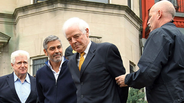 PHOTO: Journalist Nick Clooney and his son actor George Clooney are arrested by members of the U.S. Secret Service Uniform Division during a protest outside the Sudanese Embassy March 16, 2012 in Washington, DC.