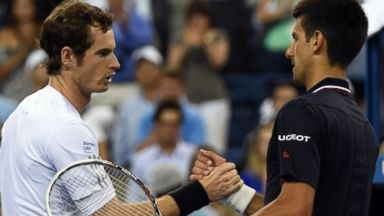 PHOTO: Novak Djokovic meets Andy Murray at the net after their US Open mens quarterfinals match on Sept. 3, 2014 in New York.