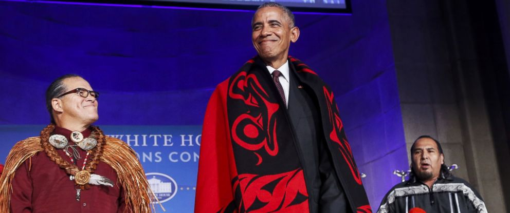 PHOTO: Barack Obama receives a traditional blanket and hat during the 2016 White House Tribal Nations Conference at the Andrew W. Mellon Auditorium, Sept. 26, 2016, in Washington.