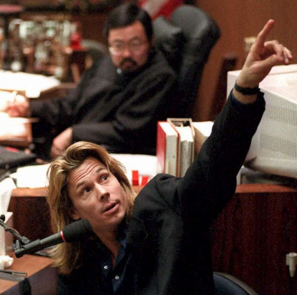 PHOTO: Judge Lance Ito watches as Brian Kato Kaelin points to a video screen showing the path behind his bedroom where the bloody glove was found by police detective Mark Fuhrman during his testimony on March 22, 1995.