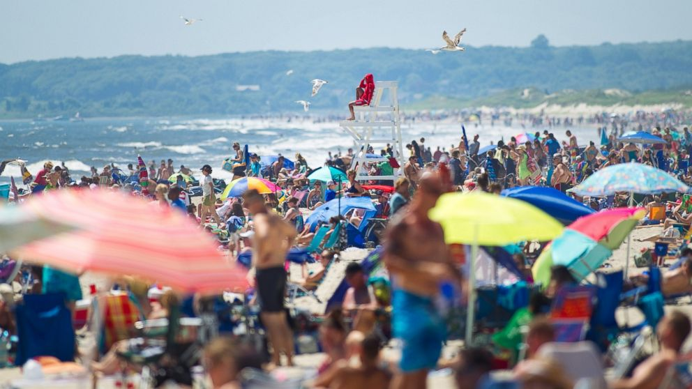 Beachgoers enjoy the weather at Horseneck Beach in Westport, Mass. on July 6, 2014.