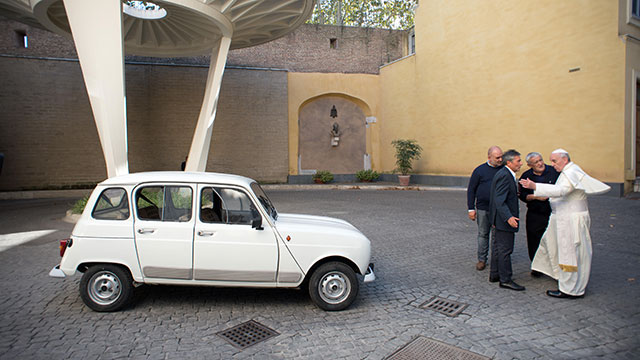 PHOTO: This handout picture released by the Vatican Press Office shows Father Don Renzo Zocca (2ndR) offering his white Renault 4L to Pope Francis during a meeting, Sept. 7, 2013, at the Vatican.