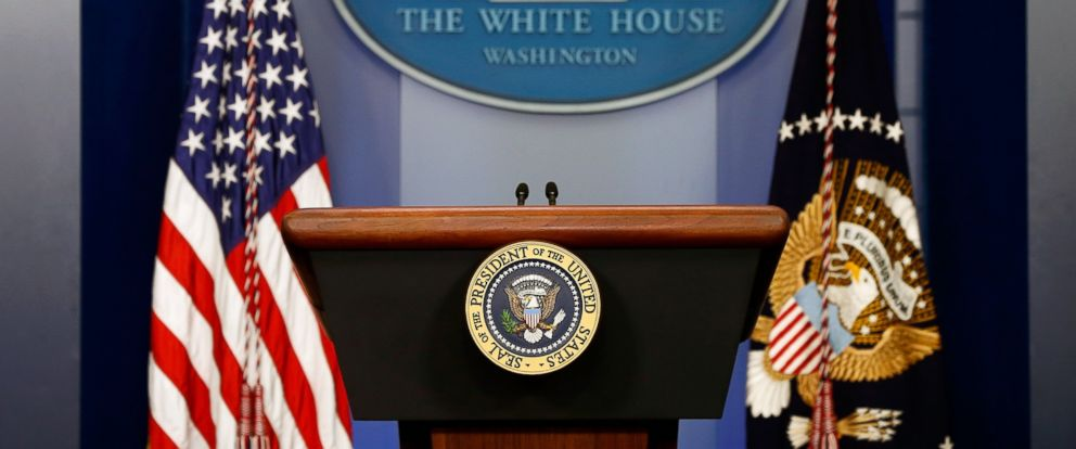 PHOTO: The American flag sits next to a empty speaker podium before U.S. President Barack Obama gives a statement during a press conference in the Brady Press Briefing Room of the White House on Aug. 18, 2014 in Washington.