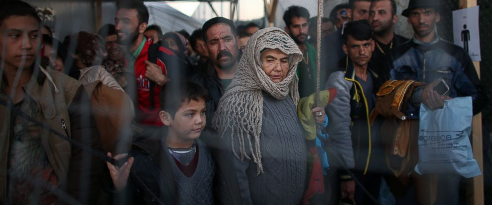 PHOTO: Migrants and refugees wait in a queue after making the crossing from Turkey to the Greek island of Lesbos on Nov. 14, 2015 in Sikaminias, Greece.