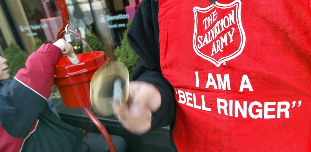 PHOTO: A donation is made as Salvation Army bell ringer Ruben Rios works outside a store as seen in this file photo taken on November 21, 2003 on the Magnificent Mile in Chicago.