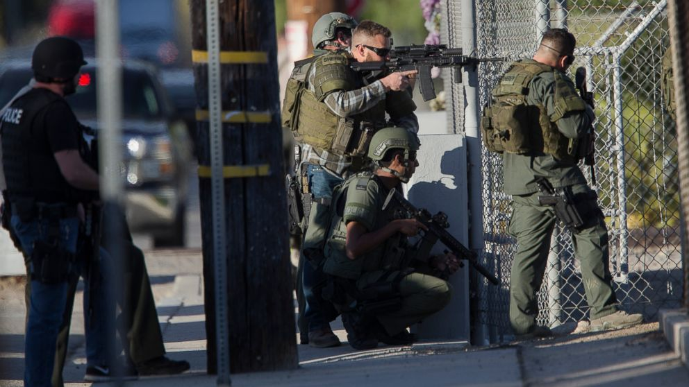 SWAT officers search near Victoria Elementary School on Richardson Street for the suspects involved in the mass shooting of 14 people at the Inland Regional Center on Dec. 2, 2015 in San Bernardino, Calif.