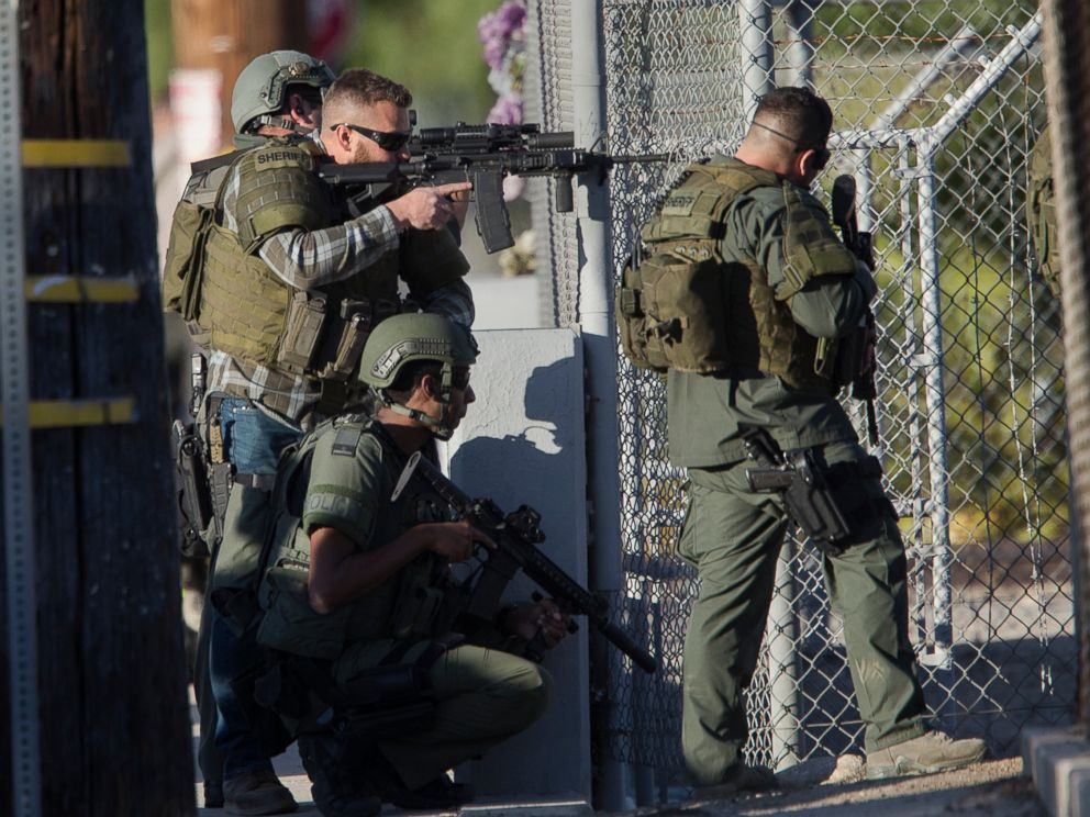 PHOTO: SWAT officers search near Victoria Elementary School on Richardson Street for the suspects involved in the mass shooting of 14 people at the Inland Regional Center on Dec. 2, 2015 in San Bernardino, Calif.