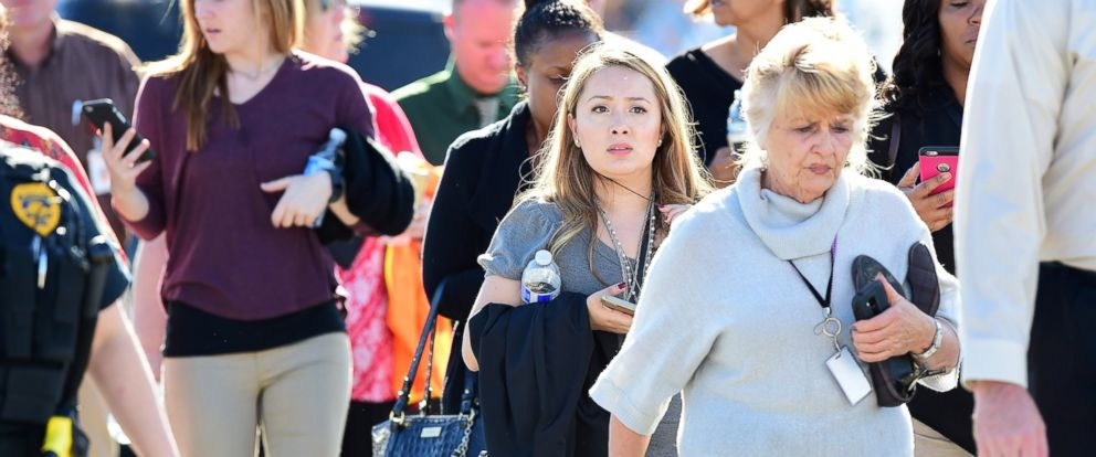 PHOTO: Survivors are evacuated from the scene of a shooting on Dec. 2, 2015 in San Bernardino, Calif.