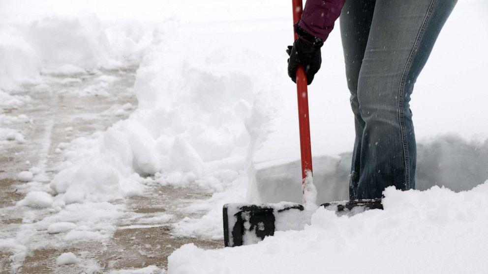 PHOTO: A person shovels snow.