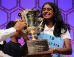 The 2012 Scripps National Spelling Bee winner, Snigdha Nandipati of San Diego, Calif., holds the trophy after she has won the competition, May 31, 2012.