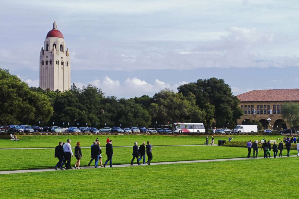 People walk on the campus at Stanford University in Stanford, Calif. in an undated stock photo.