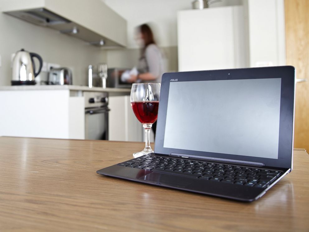 PHOTO: A laptop on a kitchen table with a glass of red wine, in this stock photo taken on July 23, 2012.