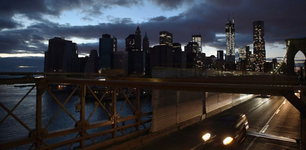 PHOTO: The partially lit skyline of lower Manhattan is seen from the Brooklyn Bridge, Nov. 3, 2012, in New York.